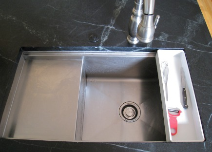 Kohler stages sink with knife tray in black and white kitchen island