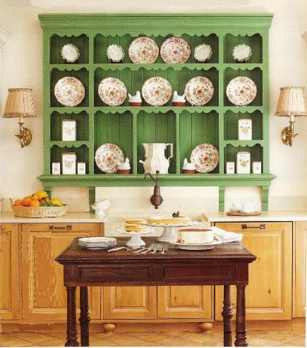 green open antique-style shelves in a renovated kitchen