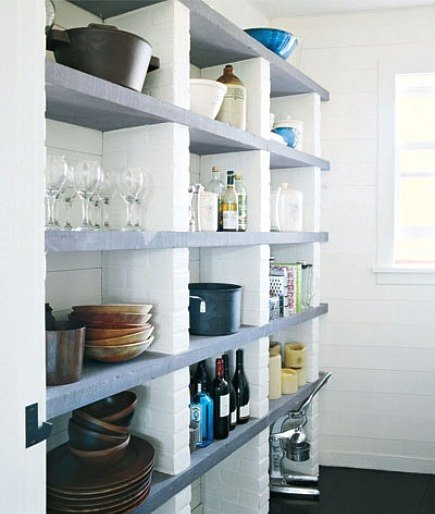 open pantry made from painted bricks and concrete shelves Meg Ryan