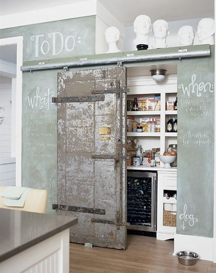 pantry ideas - kitchen pantry hidden by interior industrial sliding barn door - via Atticmag