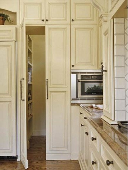 pnatry ideas - pantry entrance hidden with integrated panel doors - via Atticmag