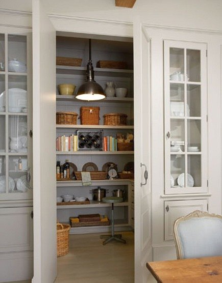 pantry ideas - pantry with integrated panel doors flanked by glass door dish storage - via Atticmag