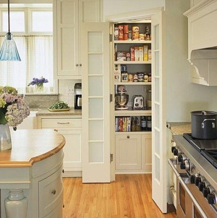 pantry ideas - corner pantry with double french doors and frosted glass - via Atticmag