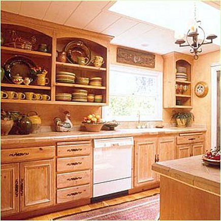 kitchen cabinet doors - open upper cabinets with arched tops in natural wood - Cottage Flourishings via Atticmag