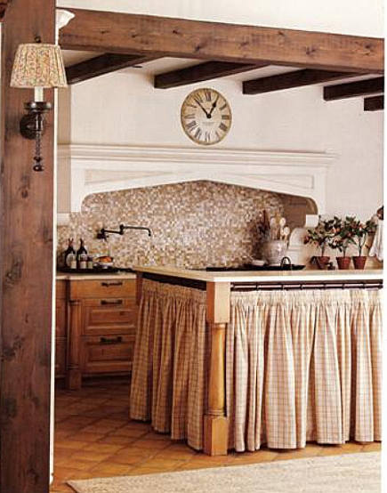 cabinet skirts - designer kitchen with shirred fabric on rings as skirt for an island - BH&G via Atticmag