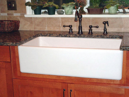 Farm sink installed with custom cut outs to cradle the bottom of the sink