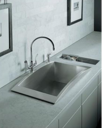 Kohler Undertone trough sink installed next to a Verve drop-in