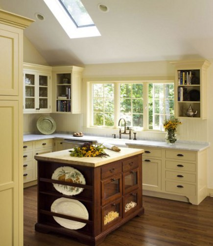 yellow kitchen with antique wood island