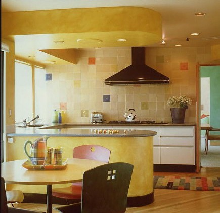 yellow kitchen by Linda Applewhite that uses colors from a Mondrian painting - via Atticmag