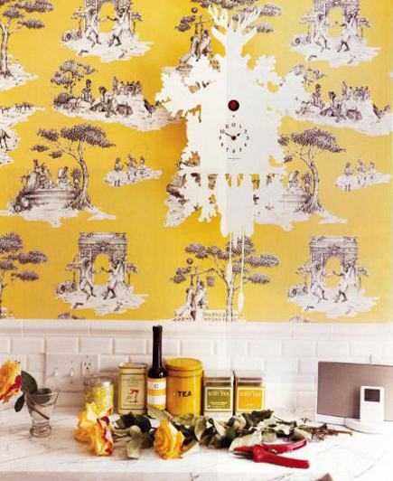 Sheila Bridges kitchen with her yellow Harlem toile de jouy wallpaper and Tord Boontje cukoo clock