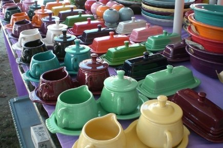 contemporary fiestaware on a dealer's table at Brimfield Antiques show - Atticmag