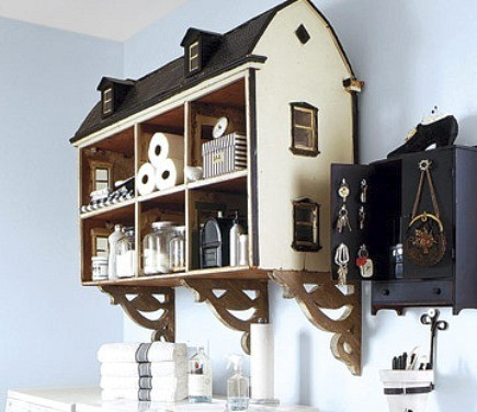 vintage dollhouse used as shelves storage cubbies in laundry room