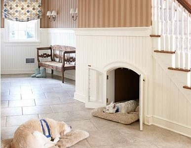 custom built-in dog bed area with doors under staircase via Atticmag
