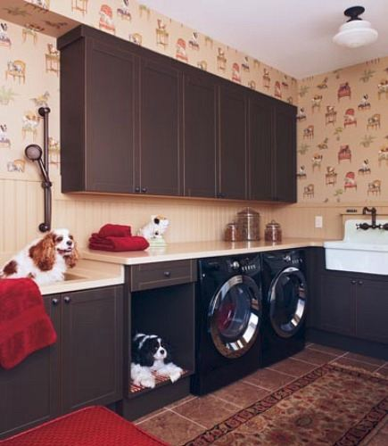 custom laundry room with built-in dog bed area and grooming sink