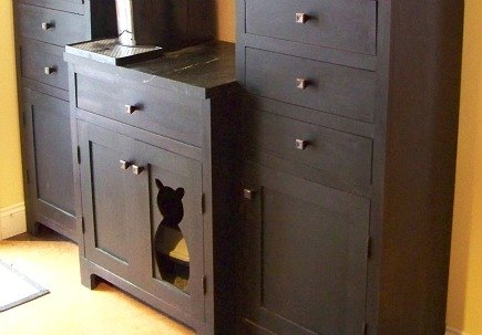 custom hutch with cat silhouette door cut out for hidden litter box via Atticmag