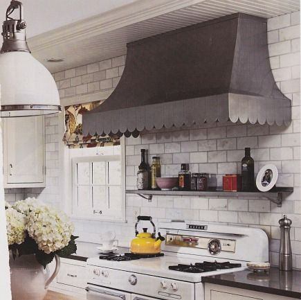 custom stainless steel sweeping hood with scalloped trim from Renovation Style