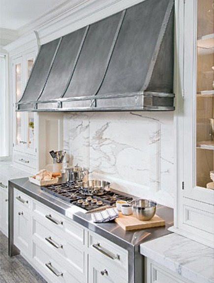 custom stainless steel range hood by O'Brien Harris - House Beautiful via Atticmag