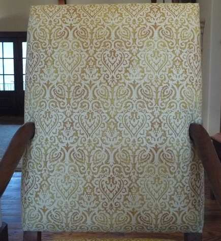 honey linen fabric detail covering French os de mouton chairs