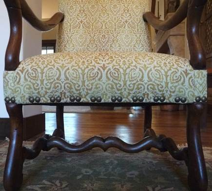 honey linen fabric and nailhead trim spacing detail on French os de mouton chairs