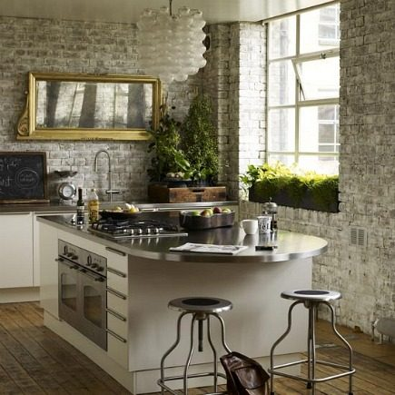 modern white kitchen cabinets with exposed brick walls