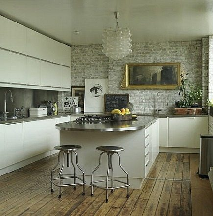 modern white kitchen cabinets and exposed brick walls
