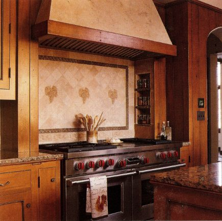range niche with Wolf dual fuel in custom maple cabinet kitchen