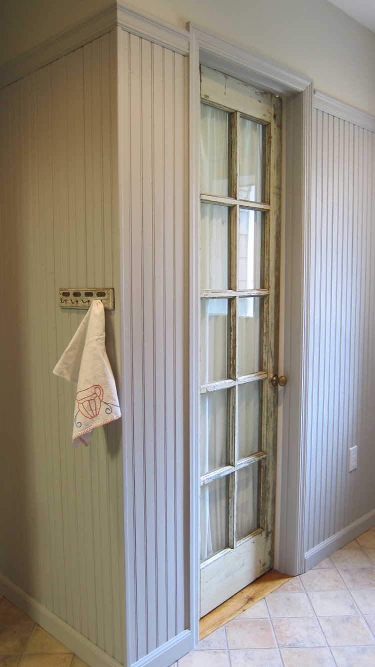 french door curtain - finished curtain seen on the door from the hallway - atticmag.com