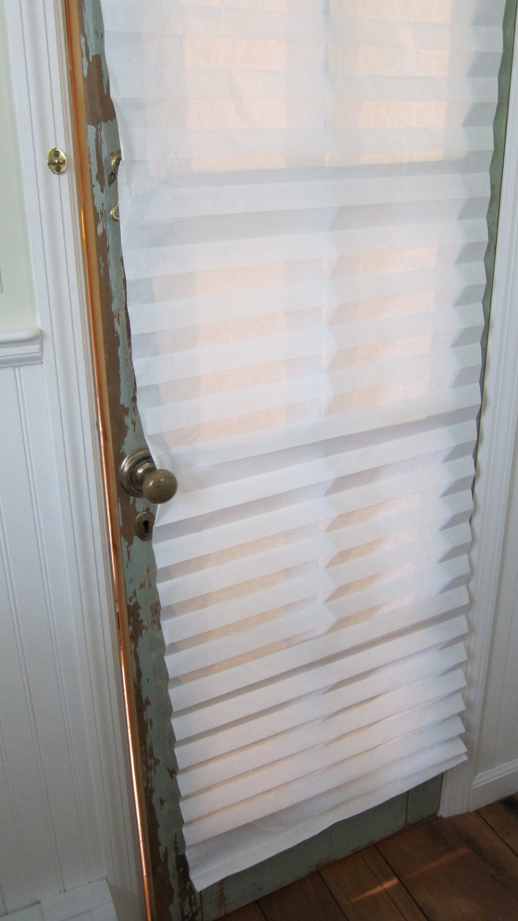 french door curtain - temporary redi shade paper window covering on the powder room door - Atticmag.com