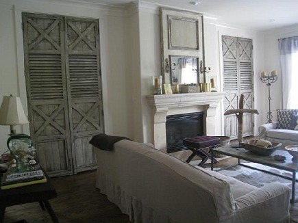 pair of shutters made into doors on either side of fireplace
