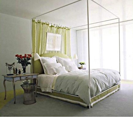 canopy beds - silver-tone framed bed with curtain behind the headboard in a bedroom by Vicente Wolf via Atticmag