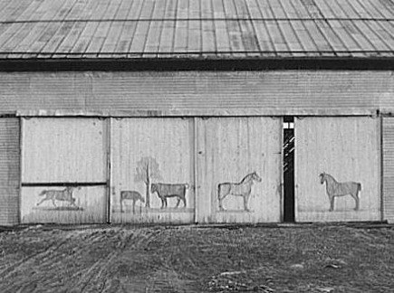 decorative interior barn doors - 1941 photograph of painted barn doors with animal silouhettes from backcountry notes - via atticmag