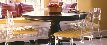 Plexi-Craft George II chairs paired with traditional round pedestal dining room table