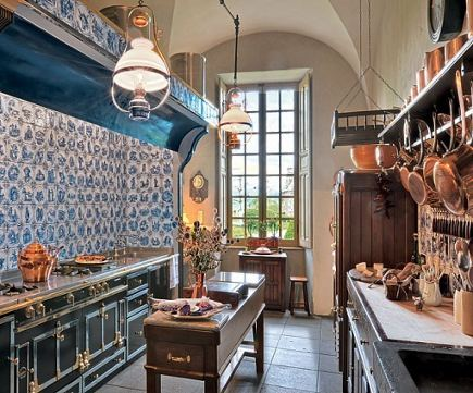 figural blue-and-white Delft tiles in a French kitchen