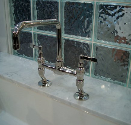 Kallista For Town by Michael Smith bridge faucet with lever handles and offset legs