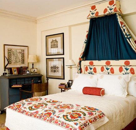 Bedroom with suzani bed cover and Bridgette Singh Poppy on Cream fabric in bedroom by Sara Gilbane
