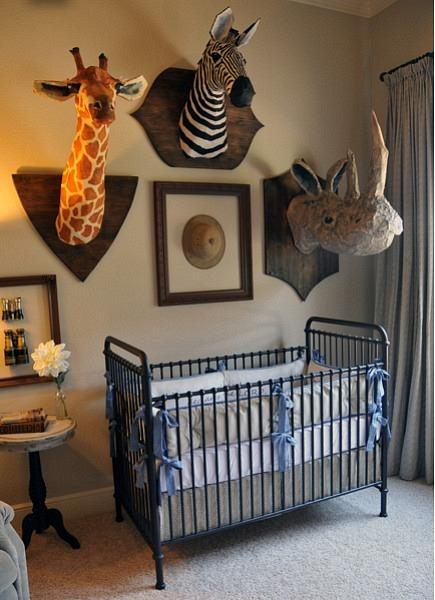 safari theme nursery with paper mache trophy animals