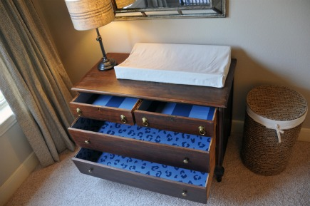 safari theme nursery dresser drawers lined with blue cheetah fabric