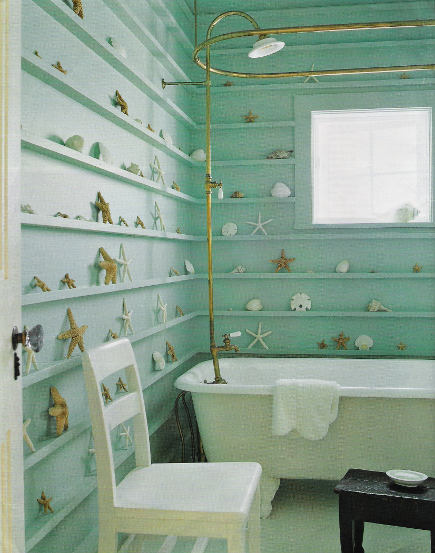 beach cottage bathroom - aqua bath by Jacques Grange with clawfoot tub and shallow shelves with starfish collection displayed - Elle Décor via Atticmag
