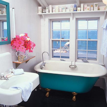 white cottage beach house bath with turquoise clawfoot tub