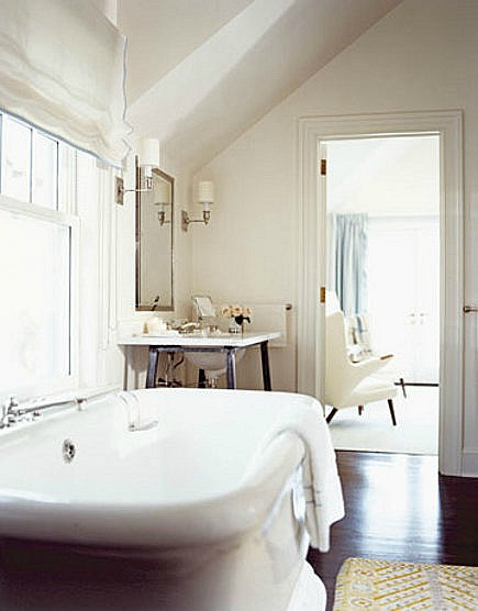 white master baths- white bathroom with mid-century style sink console and bath by David Kleinberg - HB via Atticmag