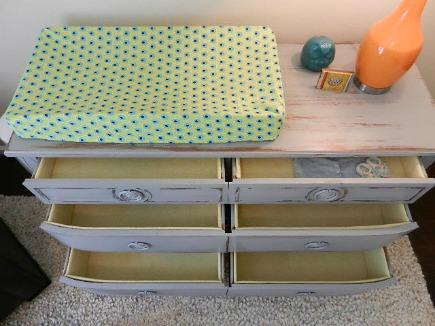 eclectic gender neutral nursery vintage dresser with fabric lined drawers
