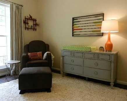 eclectic gender neutral nursery with Babyletto Nara glider in Mocha and a vintage gray dresser