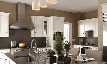 kitchen with white cabinets and dark neutral taupe walls - Patrik Lonn via Atticmag