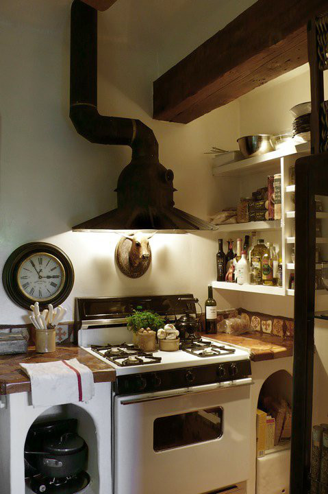 italianate kitchen - with custom round hood owned by designer Dan Marty - Maison au Naturel via Atticmag