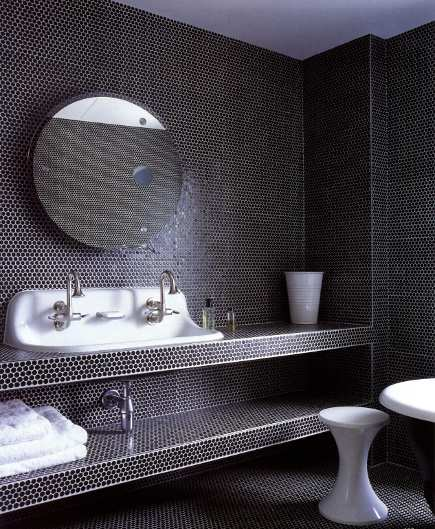 black pennyround tiled children's bathroom with lab sink