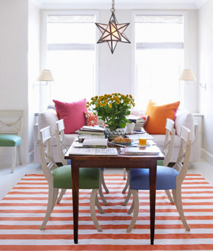 summer rugs - orange and white striped dhurrie dining room rug in a dining room by Todd Klein - House Beautiful via Atticmag
