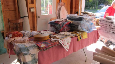 table of linens ready for the house sale
