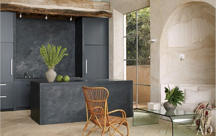 matte black lacquer kitchen cabinets and basalt volcanic stone island Archietctural Digest via Atticmag