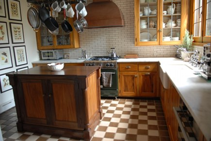 vintage gumwood kitchen with copper hood
