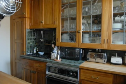 vintage gumwood cabinet kitchen with inadequate counter space before remodeling - Atticmag